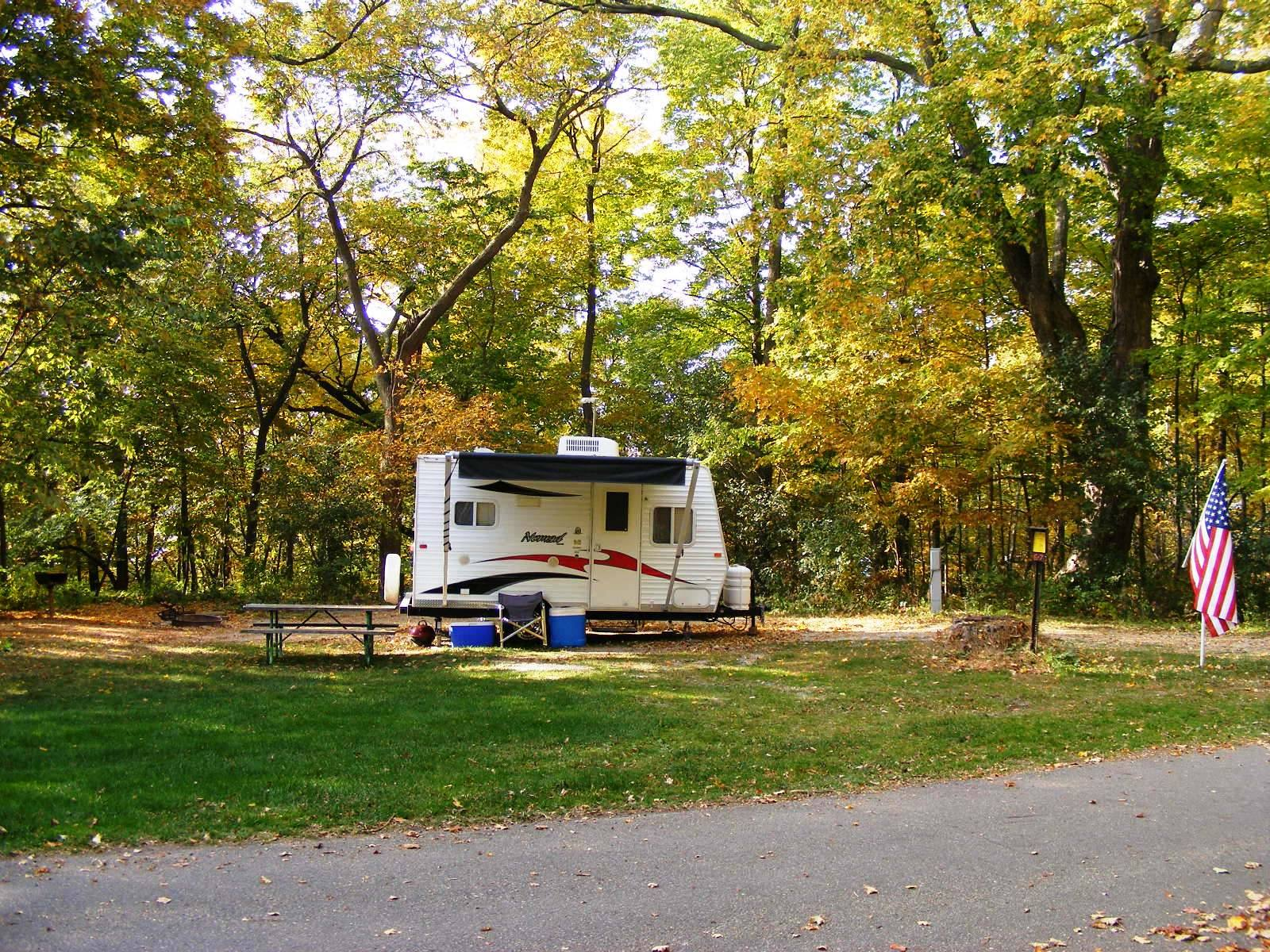 Camper in wooded area.